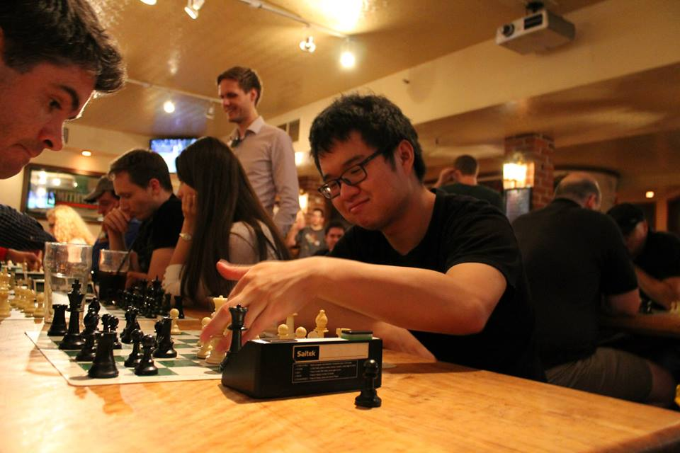 Jon Yu playing at a Pub Chess event